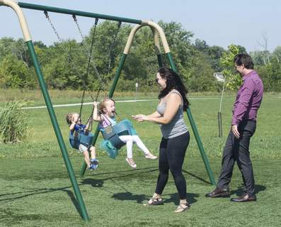Michelle Davies | The Journal Gazette Doug Hills took the opportunity to meet his wife, Brooke, and children Lennon, 4 and Harrison, 20 months, rear, during his lunchbreak Tuesday afternoon at Buckner Park.