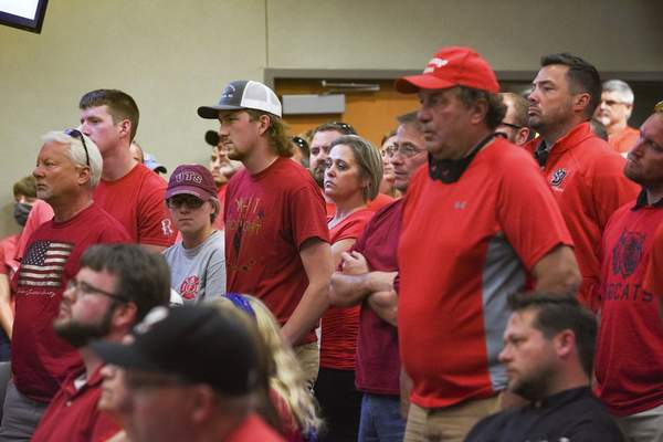 Associated Press Residents of Brookings, S.D., wear red in solidarity against a potential citywide mask mandate during a city council meeting Sept. 2.