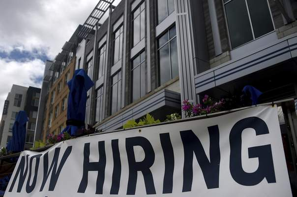 A restaurant displays a Now Hiring sign amid the coronavirus pandemic, on Aug. 4, 2020 in Arlington, VA. (Olivier Douliery/AFP via Getty Images/TNS)