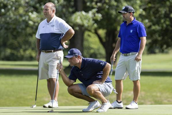 The Journal Gazette | Josh Gales  Andy Rang, left, and Karl Berhens, right, watch as Ron Schmucker lines up his putt at the 8th hole during the Senior City Championship at Coyote Creek Golf Club Sunday.