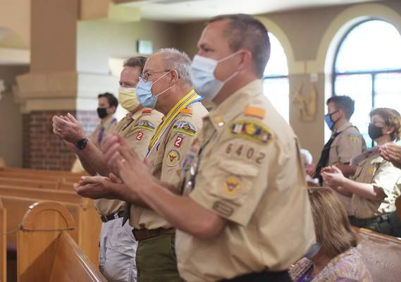 Katie Fyfe   The Journal Gazette Masked and socially distanced attendees at Sunday's ceremony applaud after Ed Keller received his Eagle Scout award.