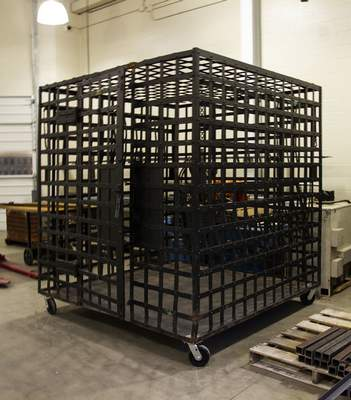 Courtesy photos Two Ivy Tech Fort Wayne staff members refurbished this portable jail, an item in the History Center's collection.