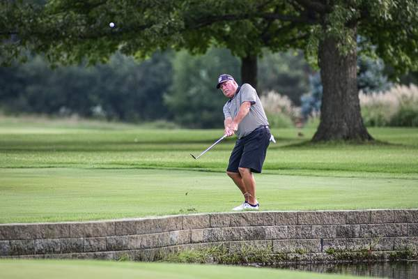 Mike Moore | The Journal Gazette Tom Wood competes in the Senior City Golf Tournament championship on Monday at Coyote Creek Golf Club.