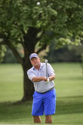 Mike Moore | The Journal Gazette Tim Dobis competes in the Senior City Golf Tournament championship on Monday at Coyote Creek Golf Club.