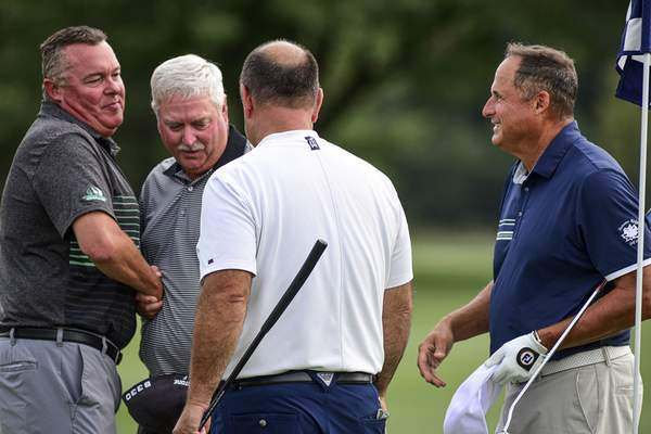 Mike Moore | The Journal Gazette From the left, Tim Wagner, Tom Wood, Andy Rang and Steve Vernasco shake hands after the 18th hole at Coyote Creek Golf Club on Monday concluding the Senior City Golf Tournament championship.