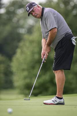 Mike Moore | The Journal Gazette Tom Wood putts during the Senior City Golf Tournament championship on Monday at Coyote Creek Golf Club.