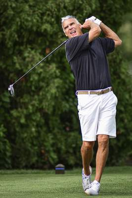 Mike Moore | The Journal Gazette Win Fisher tees off during the Senior City Golf Tournament championship on Monday at Coyote Creek Golf Club.