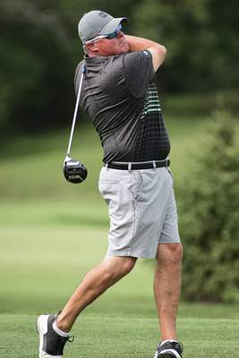 Mike Moore | The Journal Gazette Tim Wagner tees off during the Senior City Golf Tournament championship on Monday at Coyote Creek Golf Club.