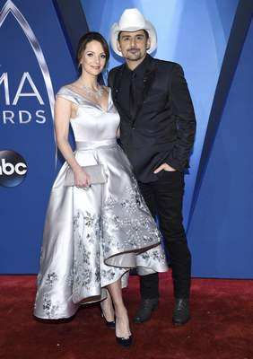 Kimberly Williams-Paisley, left, and Brad Paisley arrive at the 51st annual CMA Awards on Wednesday, Nov. 8, 2017, in Nashville, Tenn. (Photo by Evan Agostini/Invision/AP)