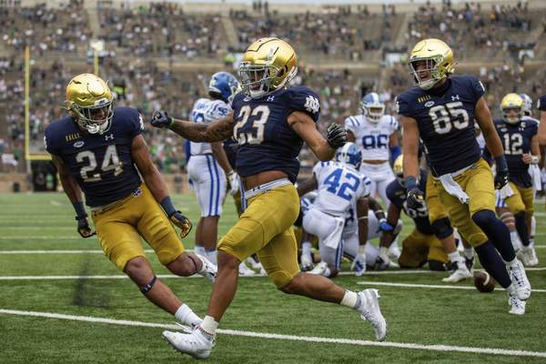 Courtesy Atlantic Coast Conference Notre Dame running back Kyren Williams,center, had more than 200 total yards in his first game as a starter.