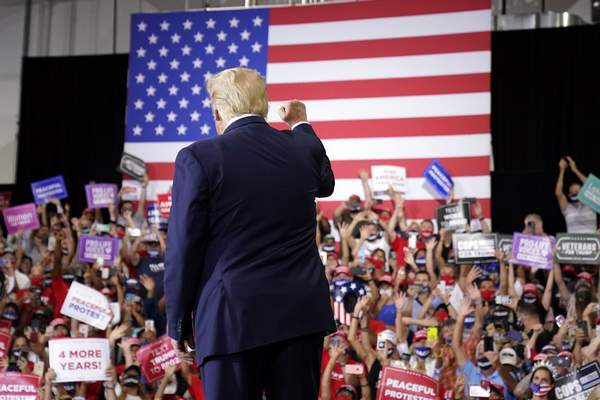 Associated Press  President Donald Trump arrives to speak at a rally at Xtreme Manufacturing in Henderson, Nev., on Sunday.