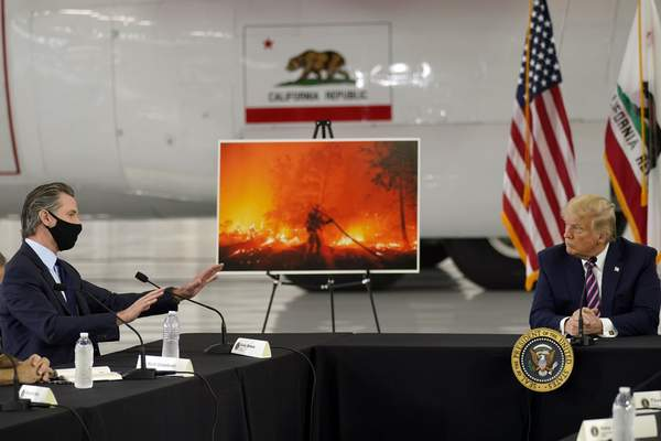 Associated Press  President Donald Trump listens as California Gov. Gavin Newsom speaks during a briefing on wildfires at Sacramento McClellan Airport in McClellan Park, Calif.,on Monday.