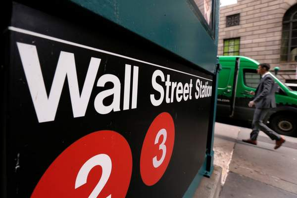 FILE- In this April 5, 2018, file photo a sign for a Wall Street subway station is shown. (AP Photo/Richard Drew, File)