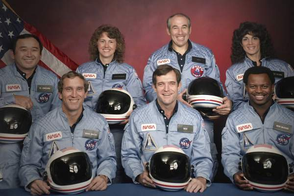 This image released by Netflix shows members of the Challenger 7 crew, from left, Ellison S. Onizuka; Mike Smith; Christa McAuliffe; Dick Scobee; Gregory Jarvis; Judith Resnik; and Ronald McNair in episode 2 of Challenger: The Final Flight. (NASA/Netflix via AP)