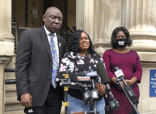 Tamika Palmer, mother of Breonna Taylor, addresses the media in Louisville, Ky. on Thursday, Aug. 13, 2020. (AP Photo/Dylan Lovan)