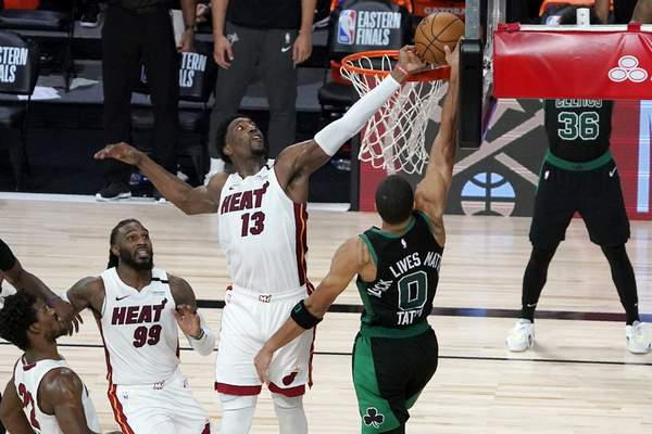 Associated Press Bam Adebayo blocks a shot Jayson Tatum in the final seconds of overtime in Game 1 of the Eastern Finals on Tuesday.