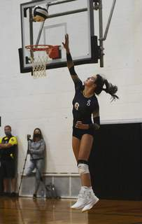 Katie Fyfe | The Journal Gazette Bishop Dwenger junior Eva Hudson serves the ball during the second set Tuesday night at Bishop Luers High School on Tuesday.