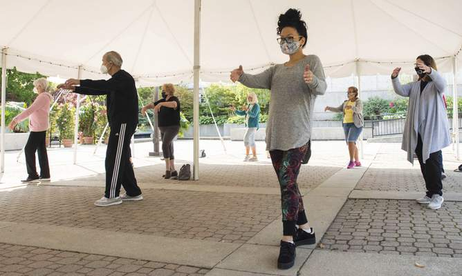 Michelle Davies | The Journal Gazette Yvonne Johnson of Fort Wayne enjoys her first tai chi class, taught by Sandy Gebhard, on Tuesday morning at Foellinger-Freimann Botanical Conservatory.