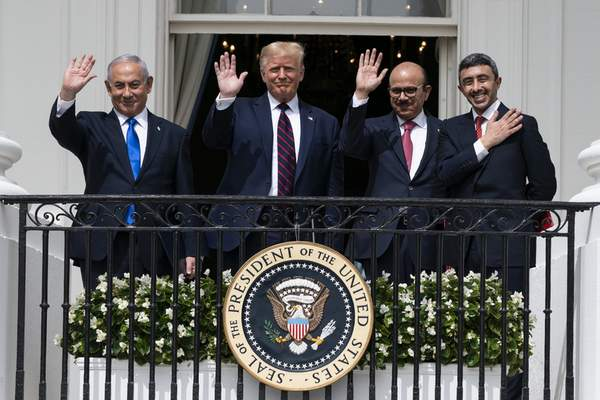Associated Press President Donald Trump stands on the Blue Room balcony Tuesday at the White House with  Israeli Prime Minister Benjamin Netanyahu, left;  United Arab Emirates Foreign Minister Abdullah bin Zayed al-Nahyan, right; and Bahrain Foreign Minister Khalid bin Ahmed Al Khalifa.
