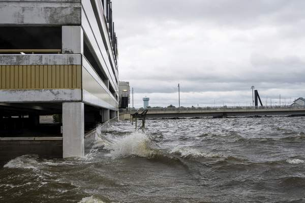 Associated Press The storm surge from Hurricane Sally overtakes the parking lot and the first floor of the Palace casino parking garage Tuesday in Biloxi, Miss.