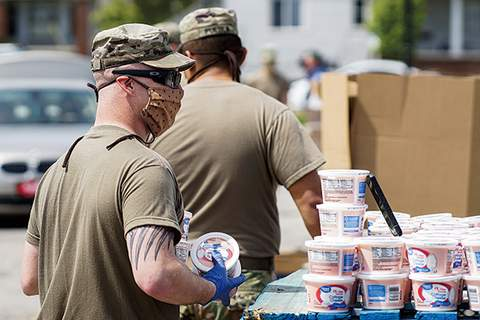 File National Guard members assist at a Community Harvest food giveaway at Parkview Field in April.