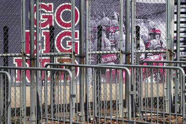 A mural showing Nebraska football players and Go Big Red lettering are seen past locked gates at Memorial Stadium in Lincoln, Neb., Tuesday, Sept. 15, 2020. (AP Photo/Nati Harnik)