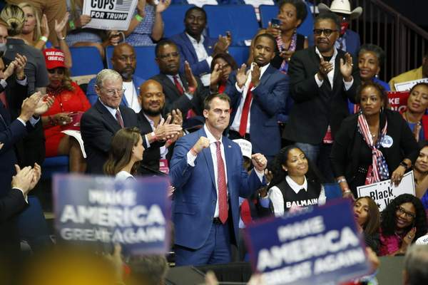 FILE - In this June 20, 2020 file photo, Oklahoma Gov. Kevin Stitt is recognized as President Donald Trump speaks during a campaign rally at the BOK Center in Tulsa, Okla. (AP Photo/Sue Ogrocki, File)
