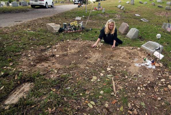 FILE - In this Oct. 3, 2018 file photo, a distraught Jean Stott, of Shelton, Conn., tries to find the exact spot where a family member is located after the tombstone, had been moved at Park Cemetery in Bridgeport, Conn. (Christian Abraham/Hearst Connecticut Media via AP)