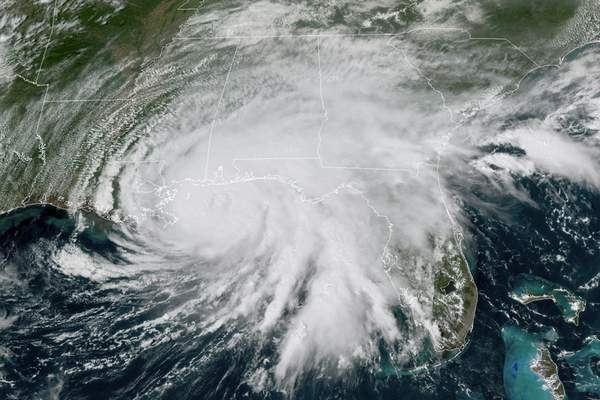 This GOES-16 GeoColor satellite image taken Tuesday, Sept. 15, 2020, at 3 p.m. EDT., and provided by NOAA, shows Hurricane Sally moving slowly towards the coast from the Gulf of Mexico. (NOAA via AP)