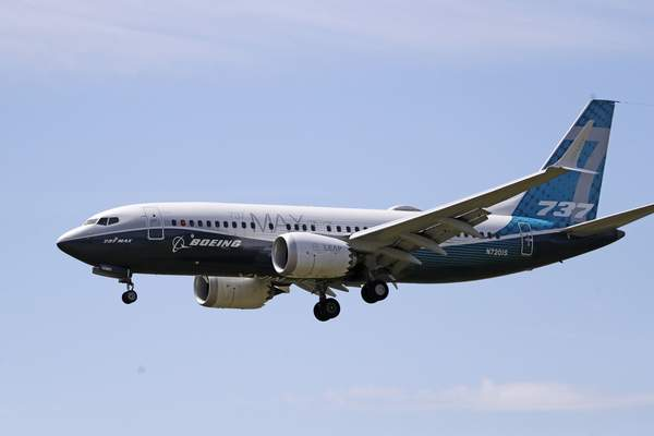 FILE - In this Monday, June 29, 2020, file photo, a Boeing 737 Max jet heads to a landing at Boeing Field following a test flight in Seattle. (AP Photo/Elaine Thompson, File)