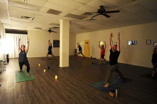 Katie Fyfe | The Journal Gazette Students in one of Christa Smith's Simply Yoga classes last week stay 6 feet apart to follow social distancing guidelines.