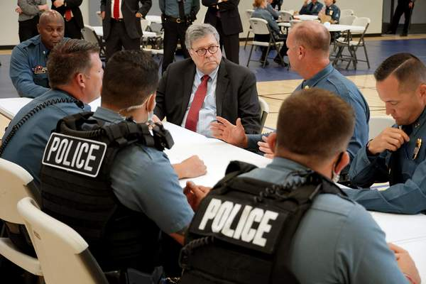 FILE - In this Aug. 19, 2020, photo Attorney General William Barr participates in a roll call with police officers from the Kansas City Police Department in Kansas City, Mo. (AP Photo/Mike Balsamo, File)