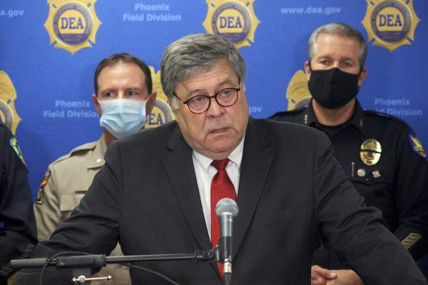 U.S. Attorney General William Barr speaks at a news conference, Thursday, Sept. 10, 2020, in Phoenix, where he announced results of a crackdown on international drug trafficking. (AP Photo/Bob Christie)