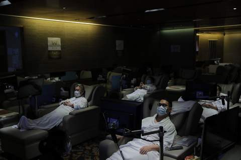 APTOPIX Virus Outbreak Hong Kong Staff members wearing face masks demonstrate the safety measures to media as the massage spa plan to be reopened in Hong Kong, Thursday, Sept. 17, 2020. (AP Photo/Kin Cheung) (Kin Cheung STF)