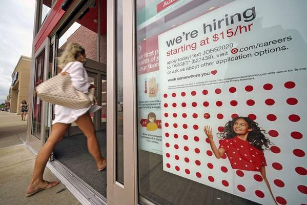 Associated Press A help wanted sign hangs on the door of a Target store in Uniontown, Pa. The Labor Department reported Thursday that 860,000 Americans applied for unemployment benefits last week.