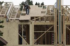 Home Construction Associated Press Workers toil on a multifamily dwelling  in Winter Park, Colo. The Commerce Department reported Thursday that housing construction fell by 5.1% in August. (David ZalubowskiSTF)