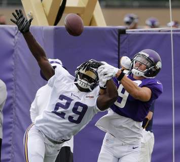 Colts Rhodes Reunion Football FILE - In this Tuesday, July 28, 2015, file photo, Minnesota Vikings cornerback Xavier Rhodes (29) breaks up a pass intended for wide receiver Adam Thielen, during practice at an NFL football training camp on the campus of Minnesota State University in Mankato, Minn. Rhodes and Thielen came to training camp together as rookies in 2013, one the Vikings first-round draft pick from Florida State, the other an undrafted rookie from Minnesota State. (AP Photo/Charles Rex Arbogast, File) (Charles Rex Arbogast STF)