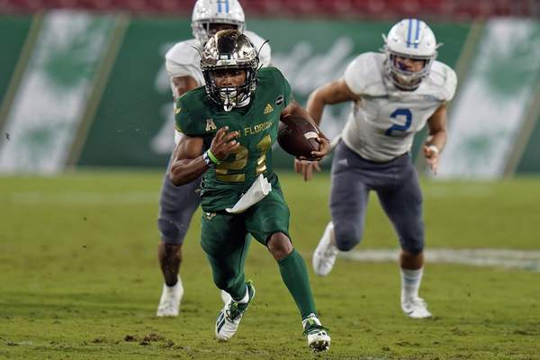 South Florida running back Brian Battie (21) outruns Citadel linebacker Andy Davis (2) during the second half of an NCAA college football game Saturday, Sept. 12, 2020, in Tampa, Fla. (AP Photo/Chris O'Meara)