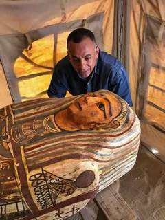 Egypt Antiquities This Sept. 2020 photo provided by the Ministry of Tourism and Antiquities shows Mostafa Waziri, secretary general of the Supreme Council of Antiquities, posing with one of more than two dozen ancient coffins unearthed near the famed Step Pyramid of Djoser in Saqqara, south of Cairo, Egypt. (Ministry of Tourism and Antiquities via AP) (HOGP)