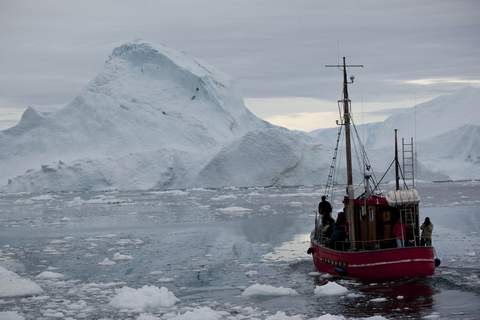 UN Record Cold FILE - In this July 18, 2011 file photo, a boat steers slowly through floating ice, and around icebergs, all shed from the Greenland ice sheet, outside Ilulissat, Greenland. (AP Photo/Brennan Linsley, File) (Brennan Linsley