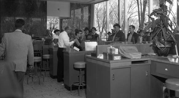 File photos Staff and customers were lined up similar to this by two gunmen robbing a branch of the Lincoln National Bank & Trust Co. on Oct. 18, 1957. They wanted anyone passing by to think everything was business as usual in the bank at Rudisill and Clinton streets.