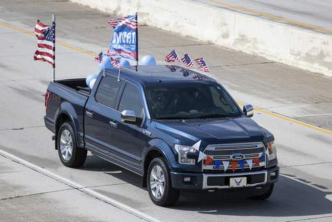 Josh Gales | Journal Gazette A truck decorated to show support for President Donald Trump drives on Interstate 469 near Thiele Road during the Circle the Fort - 469 Trump Rally on Sunday.