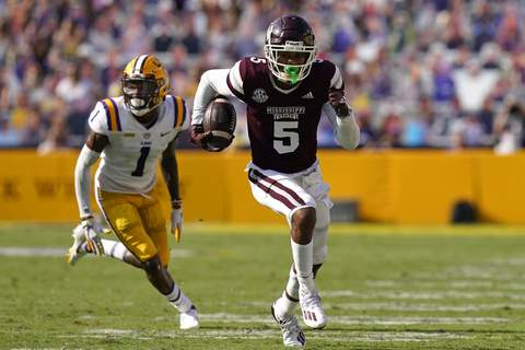 Mississippi St LSU Football Mississippi State wide receiver Osirus Mitchell (5) carries on a touchdown reception as he is pursued by LSU cornerback Eli Ricks (1) in the first half an NCAA college football game in Baton Rouge, La., Saturday, Sept. 26, 2020. Mississippi State won 44-34. (AP Photo/Gerald Herbert) (Gerald Herbert STF)