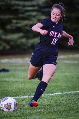 Mike Moore | The Journal Gazette DeKalb sophomore Katie Witte kicks the ball in the first half against Bellmont at DeKalb High School on Monday.
