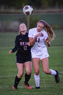 Mike Moore | The Journal Gazette DeKalb senior Grace Snyder, left and Bellmont sophomore Haleigh Wesley collide while charging for the ball in the first half at DeKalb High School on Monday.