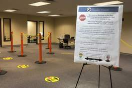 Michelle Davies | The Journal Gazette Paths to check in and testing are marked out with cones and floor stickers inside one of the new COVID testing sites in Fort Wayne.