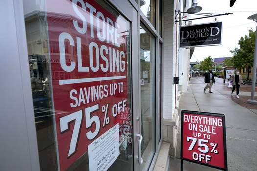 Economy GDP FILE - In this Sept. 2, 2020 file photo, pedestrians walk past a business storefront with store closing and sale signs in Dedham, Mass. (AP Photo/Steven Senne) (Steven Senne STF)