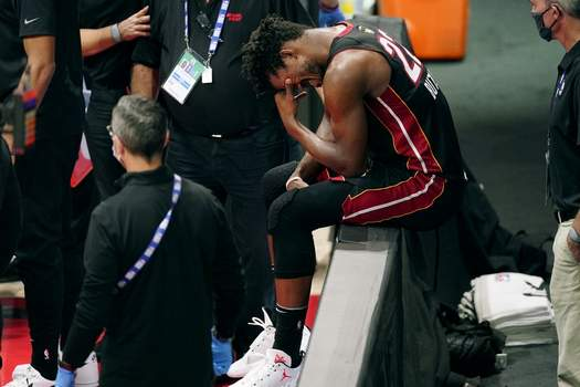 Miami Heat's Jimmy Butler (22) pauses after an apparent injury during the first half of Game 1 of basketball's NBA Finals Wednesday, Sept. 30, 2020, in Lake Buena Vista, Fla. (AP Photo/Mark J. Terrill)