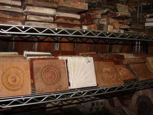 Decorative wooden pieces pulled from homes line the shelves at Reclaimed Fort Wayne.