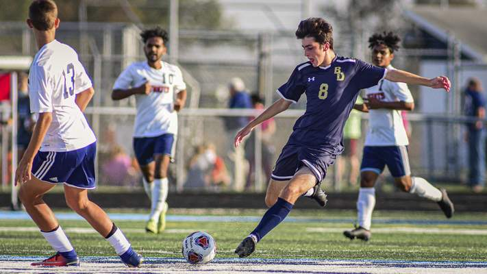 Mike Moore | The Journal Gazette Bishop Dwenger sophomore Tyler Yaggy lines up a kick against Heritage during the boys soccer sectional at Etzler Field in Woodburn on Tuesday.
